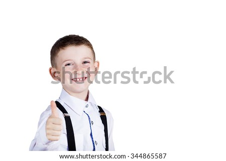 Little boy with thumb up gesture isolated over grey background.Portrait of confident happy little boy showing thumbs up gesture wearing costume  isolated over white