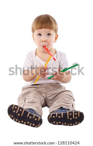 Little boy with toothbrush in the mouth, isolated on white - stock photo