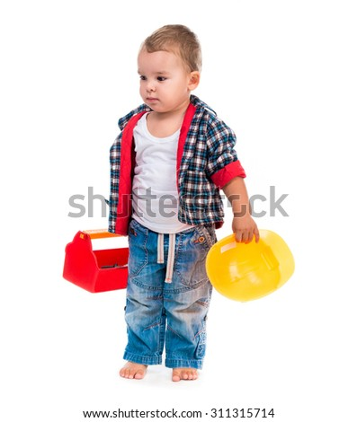 little boy with toy tools and helmet isolated on white background - stock photo