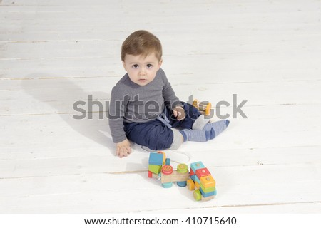 little boy with toys - stock photo