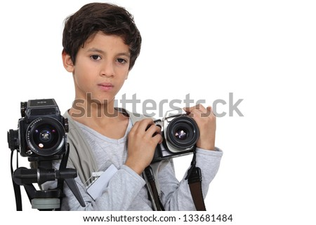 Little boy with two cameras - stock photo
