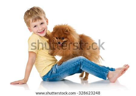 Little boy with two dog spitz, isolated on white background - stock photo