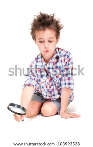 Little boy with weird hair researching using magnifier  isolated on white - stock photo