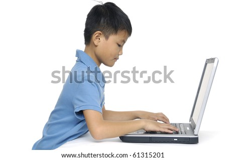 little boy working on laptop-isolated - stock photo