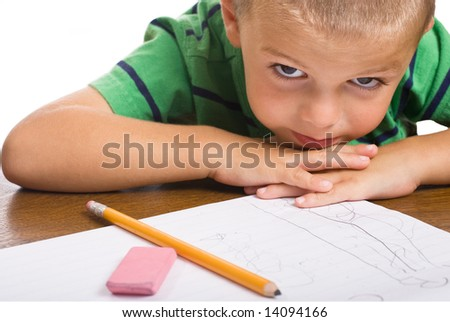 Little Boy writing alphabet. Pencil and Eraser in forefront.