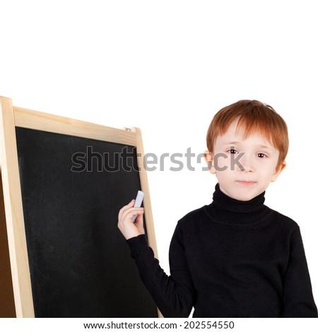 little boy writing on the blackboard - stock photo