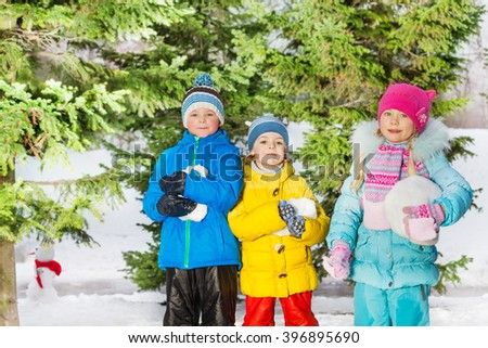 Little boys and girls play with snow - stock photo