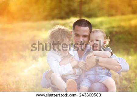 Little boys and their dad enjoying their time together outside in nature