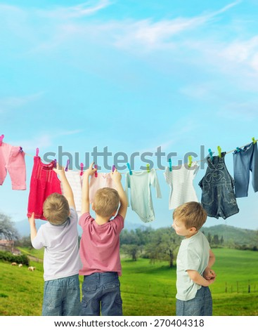 Little boys hanging laundry - stock photo