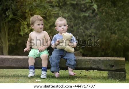 Little boys having fun together outdoors in the garden
