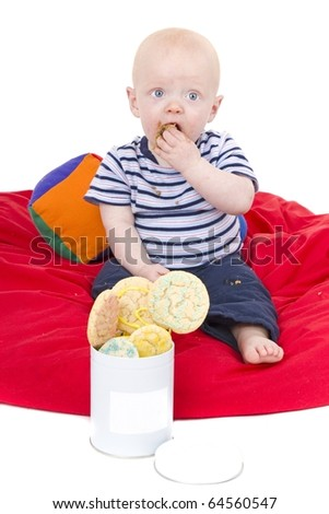 Little Boys love to eat cookies - stock photo
