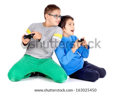 little boys playing videogames - stock photo