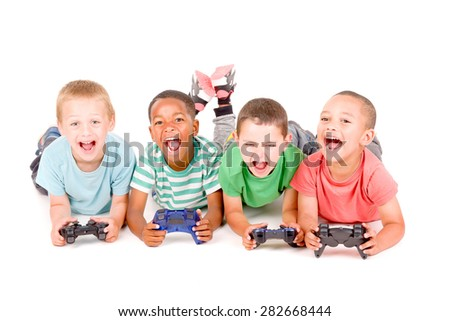little boys playing videogames isolated in white background - stock photo