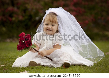 Little Bride.  Adorable toddler dressed as a little bride.   - stock photo