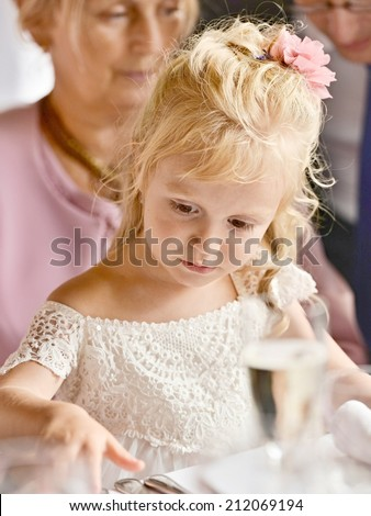 Little Bridesmaid sitting on grandmother - stock photo