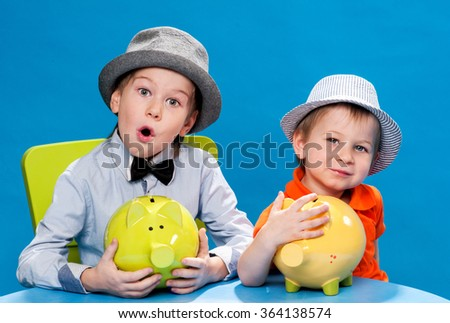 Little brothers businessmans counting money - stock photo