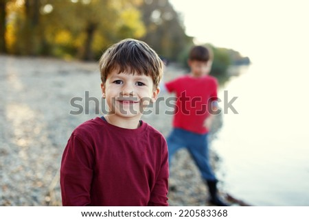 Little brothers portrait at river, outdoor, childhood - stock photo