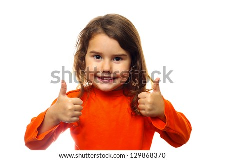 Little brunette curly girl in an orange jacket, showing two thumbs up isolated on white background - stock photo