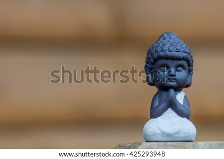 Little Buddha statue image used as amulets of Buddhism religion. Meditation concept with empty space for text - stock photo
