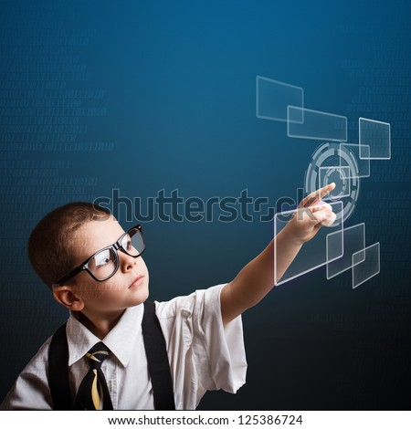 Little business boy pressing digital button - stock photo