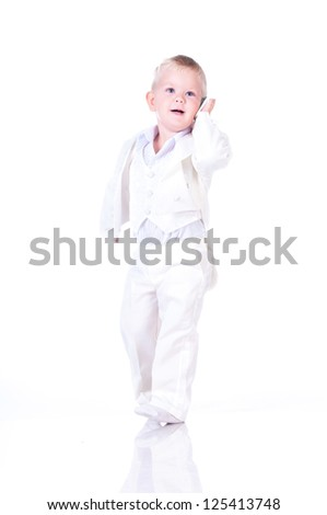 Little businessman in a business suit with phone in hand - stock photo