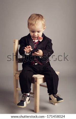 little businessman with mobile phone - stock photo