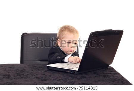 Little businessman working with computer - stock photo