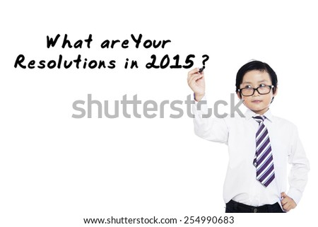 Little businessman writes a question about resolutions in 2015