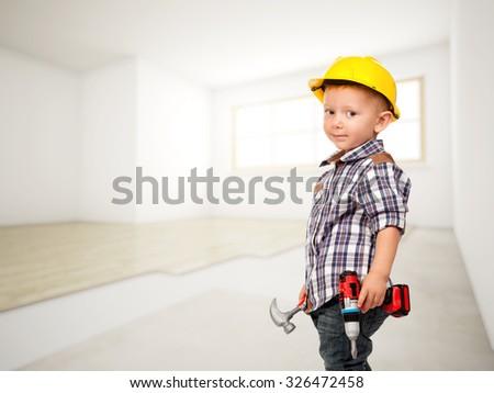 little carpenter at construction site - stock photo