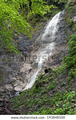 Little cascade in the Austrian mountains - stock photo