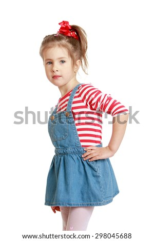 Little Caucasian blond girl in a short denim dress and red striped t-shirt posing for the camera-Isolated on white - stock photo