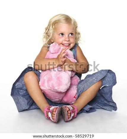little caucasian blonde kid on white floor - stock photo