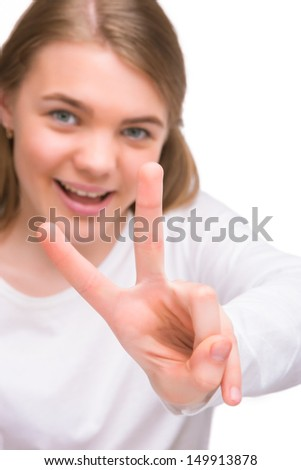 little caucasian girl showing victory V sign isolated over white. vertical shot - stock photo