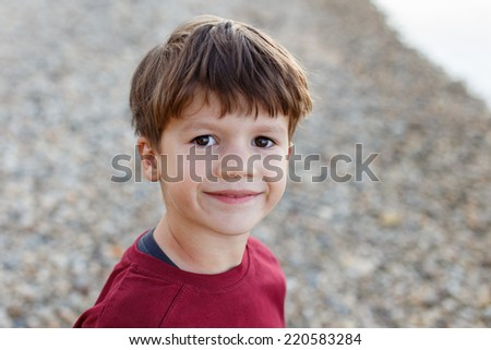 Little caucasian preschooler boy at river, outdoor portrait - stock photo