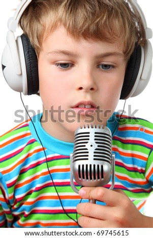 Little cheerful boy in headphone with microphone in hands opened slightly mouth  on a white background - stock photo