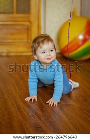 Little cheerful child plays. Happy sweet cute face. - stock photo