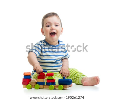 little cheerful child with block toys - stock photo