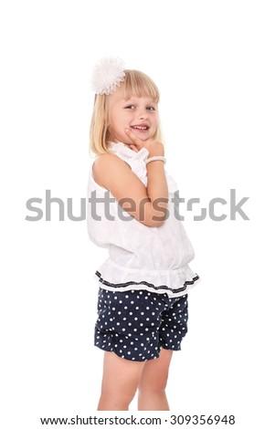 Little cheerful girl schoolgirl isolated on white background - stock photo