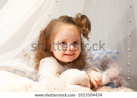 Little cheerful girl with toys