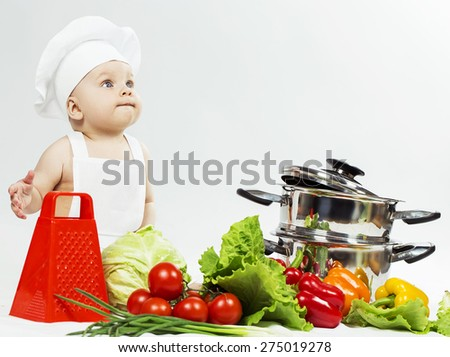 Little Chef boy preparing healthy food over white background. the concept of vegetarianism - stock photo