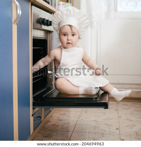 little chef cooks in the oven food