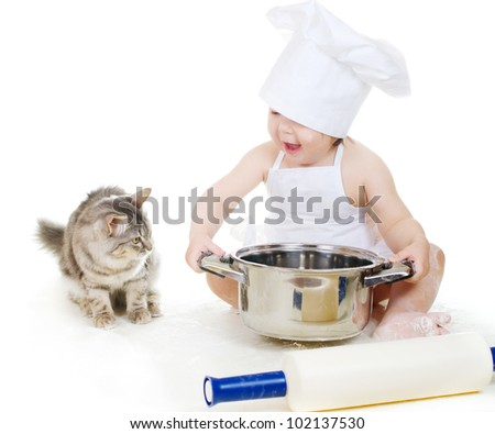 Little chef girl and kitten preparing food together. On white background - stock photo
