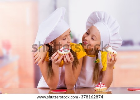 little chef in the kitchen playfully prepared from flour - stock photo
