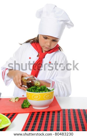 Little Chef in uniform. Isolated on white background