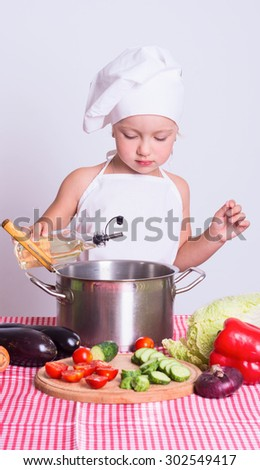 Little chef preparing a meal of vegetables
