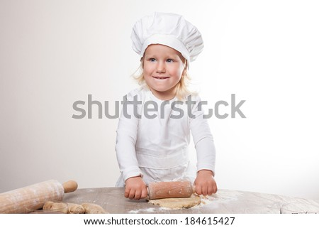 little chef unrolls gingerbread dough