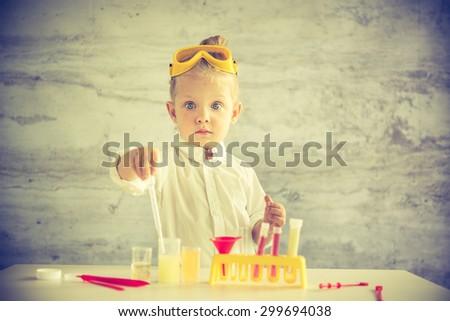 Little chemist - stock photo