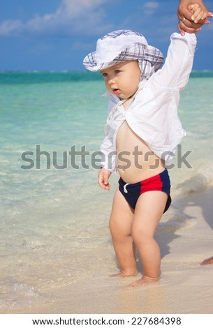 little child at the beach