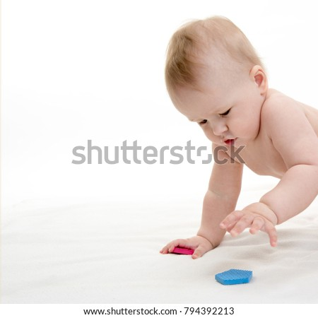 little child baby boy  isolated on white studio shot playing