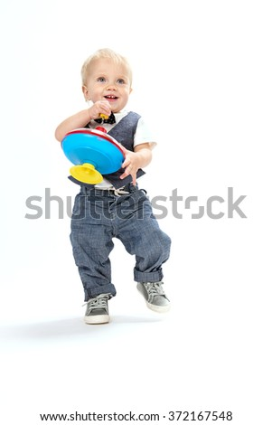 little child baby boy smiling playing with toy isolated on white background studio shot caucasian 1 year - stock photo